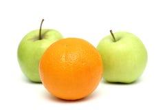 Pommes et orange Photographie stock