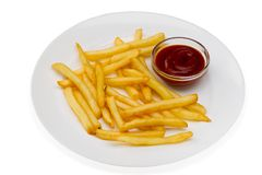 Pommes frites avec de la sauce rouge d'un plat blanc Photos stock