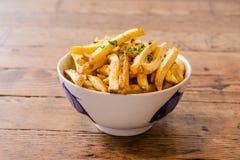 Pommes frites avec des herbes Photographie stock libre de droits