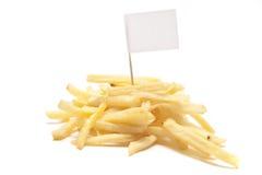 Pommes frites avec l'indicateur blanc sur le blanc Photos libres de droits