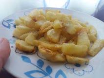Pommes frites d?ner d?licieux Pr?paration de la nourriture image libre de droits
