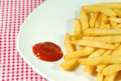 Pommes frites d'une plaque Images stock
