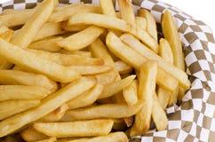 Pommes frites dans le panier Photo libre de droits