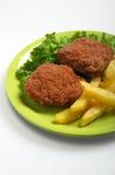 Pommes frites et boulettes de viande Image libre de droits