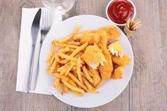 Pommes frites et poulet frit image libre de droits