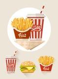 Pommes frites et soude dans la tasse de papier Photographie stock libre de droits