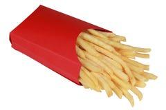 Pommes frites i en ask arkivfoton