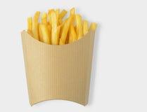 Pommes frites i kraft den tomma pappers- asken som isoleras på vit bakgrund med den snabba banan royaltyfri fotografi