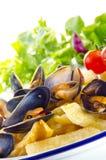 Pommes frites med musslor royaltyfria bilder