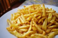 Pommes frites potatissmåfiskar, frasig potatis, arkivbild