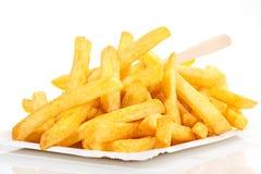 Pommes frites sur le fond blanc images stock