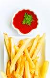 Pommes-Frites und Ketschup Stockfotos