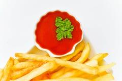 Pommes-Frites und Tomatensauce Lizenzfreie Stockfotografie