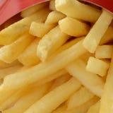Pommes fritespotatisar i rött boxas Royaltyfria Foton