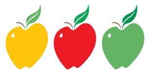 Pommes jaunes, rouges et vertes Images libres de droits