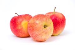 Pommes jaunes rouges sur un fond blanc Image stock