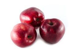 Pommes rigides rouges d'isolement sur le fond blanc Photographie stock libre de droits