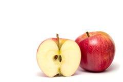 Pommes rouges d'isolement sur le blanc Image stock