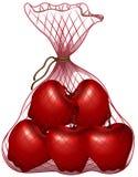 Pommes rouges dans le sac illustration libre de droits