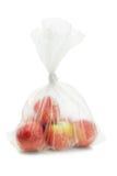 Pommes rouges dans le sachet en plastique images libres de droits