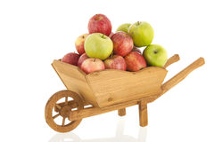 Pommes rouges et vertes de brouette Images stock