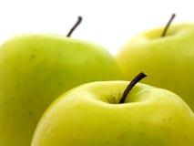 Pommes sur le blanc Photographie stock libre de droits