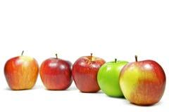 Pommes sur le fond blanc Photographie stock libre de droits