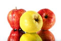 pommes trois Photo stock