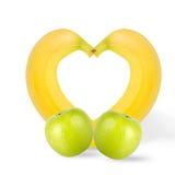 Pommes vertes avec des bananes d'isolement sur le fond blanc photographie stock