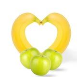 Pommes vertes avec des bananes d'isolement sur le fond blanc photographie stock libre de droits
