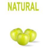 Pommes vertes avec l'inscription d'isolement sur le fond blanc image libre de droits