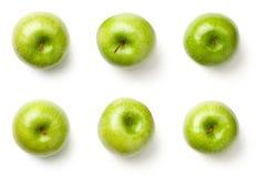 Pommes vertes d'isolement sur le fond blanc Image libre de droits