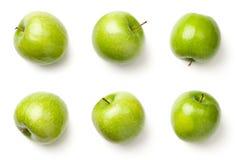 Pommes vertes d'isolement sur le fond blanc Photographie stock