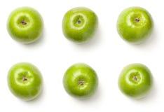 Pommes vertes d'isolement sur le fond blanc Photos libres de droits