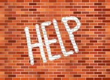 pomoc ceglana ściana Obrazy Stock