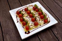 Pomodori, alimento gastronomico di Mozarella immagine stock libera da diritti