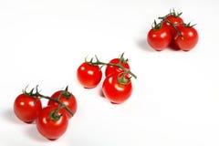 Pomodori ciliegia del mazzo del gruppo su bianco Immagini Stock Libere da Diritti