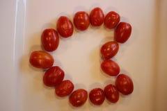 Pomodori ciliegia a forma di come un cuore Immagine Stock