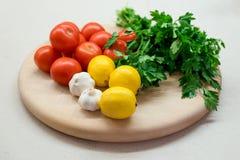 Pomodori dell'aglio del limone del prezzemolo Fotografie Stock Libere da Diritti
