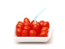 Pomodori di ciliegia con paglia Immagine Stock Libera da Diritti