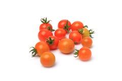 Pomodori di ciliegia freschi su priorità bassa bianca Fotografia Stock