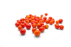 Pomodori di ciliegia su priorità bassa bianca immagine stock libera da diritti
