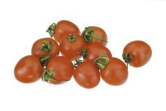 Pomodori di ciliegia su priorità bassa bianca Fotografie Stock Libere da Diritti