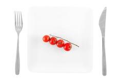 Pomodori di ciliegia su una zolla Fotografia Stock Libera da Diritti