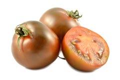 Pomodori di Kumato Immagine Stock