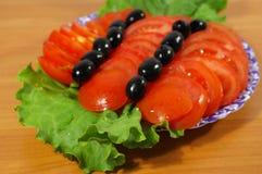 Pomodori e fogli Fotografia Stock