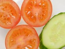 Pomodori e fondo dei cetrioli Fotografia Stock Libera da Diritti