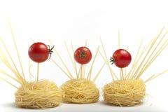 Pomodori e pasta di ciliegia. Immagine Stock