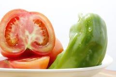 Pomodori e peperoni verdi Fotografia Stock
