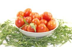 Pomodori e razzo del bambino Fotografia Stock